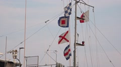 Nautical Flags Fly above Military Ship Stock Footage