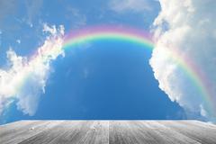 Wood terrace and sky with rainbow Kuvituskuvat