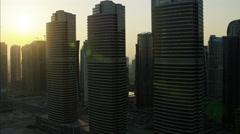 Aerial sunset Dubai Apartments Skyscrapers Persian Gulf UAE - stock footage