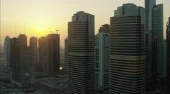 Aerial Dubai Skyscrapers sunset Development Persian Gulf UAE - stock footage