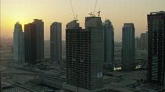 Aerial Dubai sunset Construction Building Persian Gulf UAE - stock footage