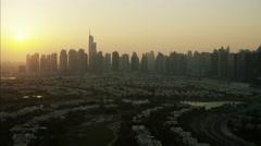 Aerial Dubai Skyscrapers sunset homes Highway Persian Gulf UAE - stock footage