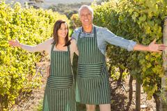 Smiling couple presenting their viticulture - stock photo