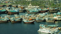 Aerial Dubai Creek Commercial Spice Port Dhow vessels Deira UAE - stock footage
