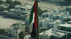 Aerial National Flag flying Pole Urban District Dubai UAE Stock Footage