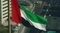 Aerial National Flag flying Pole Urban District Dubai UAE Stock Footage