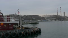 Tug Boat with Power Plant in Distance - stock footage