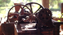 Old machine with gears mounted in an improvised way - stock footage