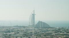 Aerial Burj al Arab 7 star hotel Dubai Marina Jumeirah Beach UAE - stock footage