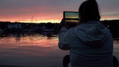 Making photos of a beautiful and breathless sunset with a tablet computer Stock Footage