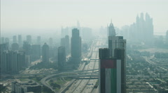 Aerial Dubai Skyscrapers Sheikh Zayed Road traffic Dubai Metro UAE - stock footage