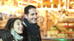 Attractive romantic couple walking through Christmas fair in the city - stock footage