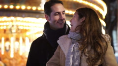 Young man surprises his girlfriend with a gift at Christmas fair - stock footage