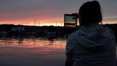 woman with iPad taking pictures of the river at the sunset - stock footage