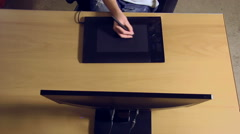 Young designer girl using graphics tablet for digital art Stock Footage