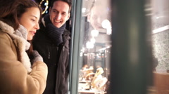Attractive romantic couple shopping in the city at Christmas time Stock Footage
