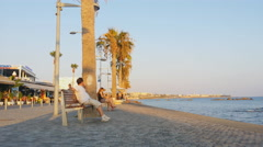 Man resting on the bench near the sea Stock Footage