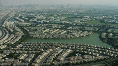 Aerial Dubai Emirates Hills Golf complex Urban suburbs Persian Gulf UAE Stock Footage