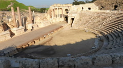 Panning shot of Time lapse of tour groups in an ancient Roman amphitheater Stock Footage