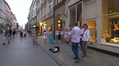 Group of musicians singing in Krakow Stock Footage
