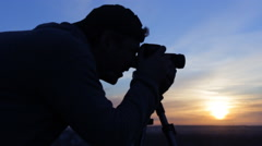Photographer at sunset Stock Footage