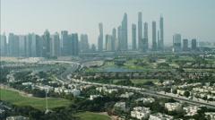 Aerial Dubai Skyline Skyscrapers Emirates Hills residential Golf UAE - stock footage