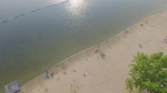 Aerial shot beach volley ball tilt up to sunset Stock Footage