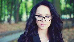 face of a beautiful girl in glasses. - stock footage