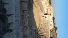 Stock Video Footage of Vertical shot of Time lapse of tour groups in an ancient Roman amphitheater