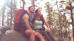 Couple resting after hiking and pointing Stock Footage