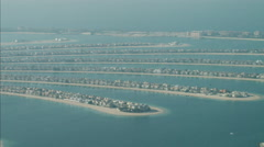 Aerial Dubai Palm Jumeirah Fronds land reclamation UAE Stock Footage