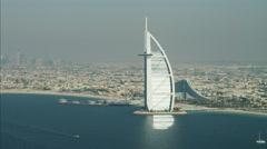Aerial Burj al Arab 7 star hotel Dubai Jumeirah Beach Hotel UAE Stock Footage