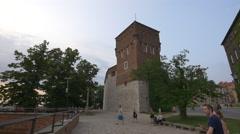 Walking near the Wawel Castle's tower in Krakow Stock Footage