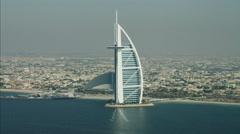 Aerial Burj al Arab 7 star hotel Dubai Jumeirah Beach Hotel UAE - stock footage