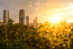 Bokeh of raindrop on glass with building background at sunset. Stock Photos