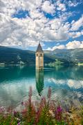 Bell tower of the Reschensee (Resia) South Tyrol Italy - stock photo
