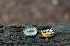 Cigarette butts in box - stock photo
