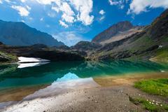 Small high mountain lake with transparent Stock Photos