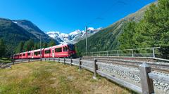 Swiss mountain train Bernina Express crossed Alps - stock photo