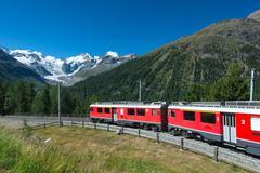 Swiss mountain train Bernina Express crossed Alps Stock Photos