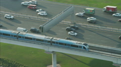 Aerial motion train Dubai Metro Rail Sheikh Zayed Road UAE - stock footage