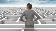 Businesswoman in a difficult maze - stock footage