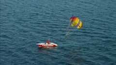 Aerial tandem Parasailing Dubai ocean adventure Persian Gulf UAE Stock Footage