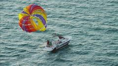Aerial tandem Parasailing Dubai ocean Persian Gulf UAE Stock Footage