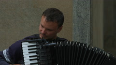 Stock Video Footage of Man playing a black accordion in Munich