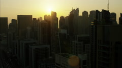 Aerial Dubai sunset City silhouette flare Skyscrapers UAE Stock Footage