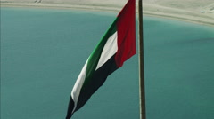 Aerial UAE National Flag flying Port Dubai Dubai Creek UAE Stock Footage