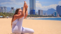 Stock Video Footage of blonde girl in lace shows yoga asana stretching leg