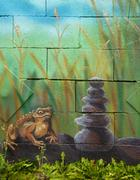 Big brown fairy-tale toad sitting on stone in grass, acryl painting - stock illustration