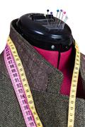 Tailoring of male woolen tweed jacket on dummy Stock Photos